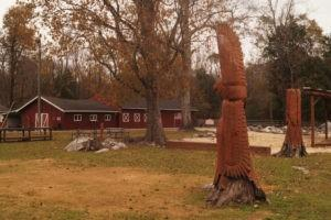 Red barn and carvings